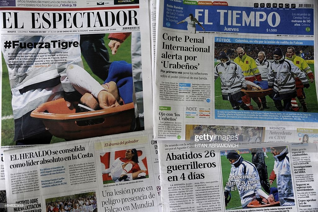 The front pages of Colombian newspapers published on January 23, 2014 and displayed at a news-stand in Bogota, show pictures of Monaco's Colombian football striker Radamel Falcao Garcia, being carried away on a stretcher following a challenge by Chasselay's Soner Ertek during a match of the French Cup on Wednesday. Falcao will require surgery on the left knee injury, while the club revealed their star forward had suffered 'an anterior cruciate ligament strain'. Falcao faces a lengthy spell on the sidelines, and although the club did not specify how long they expected him to be out of action the news will raise concern over his World Cup participation. AFP PHOTO/EITAN ABRAMOVICH
