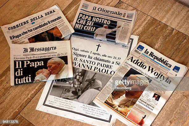 The front pages of Italian newspapers and of the Vatican newspaper L'Osservatore Romano are seen announcing the death of Pope John Paul II in Rome...
