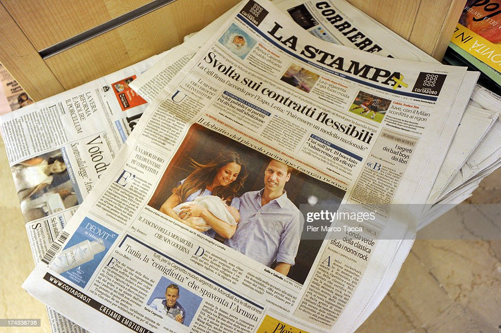 The front pages of newspapers on sale at a newstand feature photographs of Prince William, Duke of Cambridge, and Catherine, Duchess of Cambridge leaving hospital yesterday with their day-old newborn son, on July 24, 2013 in Milan, Italy. The Duke and Duchess of Cambridge returned to Kensington Palace yesterday with their day-old son, who was born on July 22 at 16:24hrs BST, weighing 8lb 6oz, at the Lindo Wing of St Mary's Hospital, London. The baby, as yet unnamed, is third in line to the throne and becomes the Prince of Cambridge.