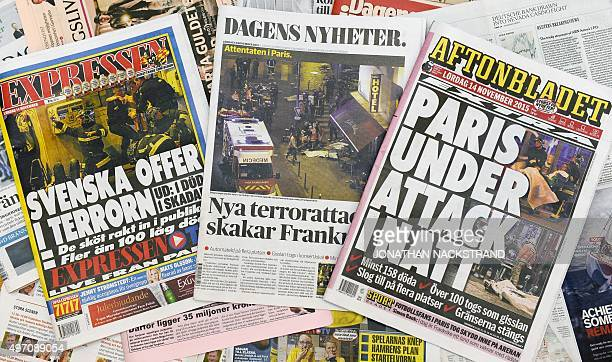 The front pages of some of Swedens daily newspapers showing pictures and headlines from the attacks in Paris are pictured in Stockholm on November 14...
