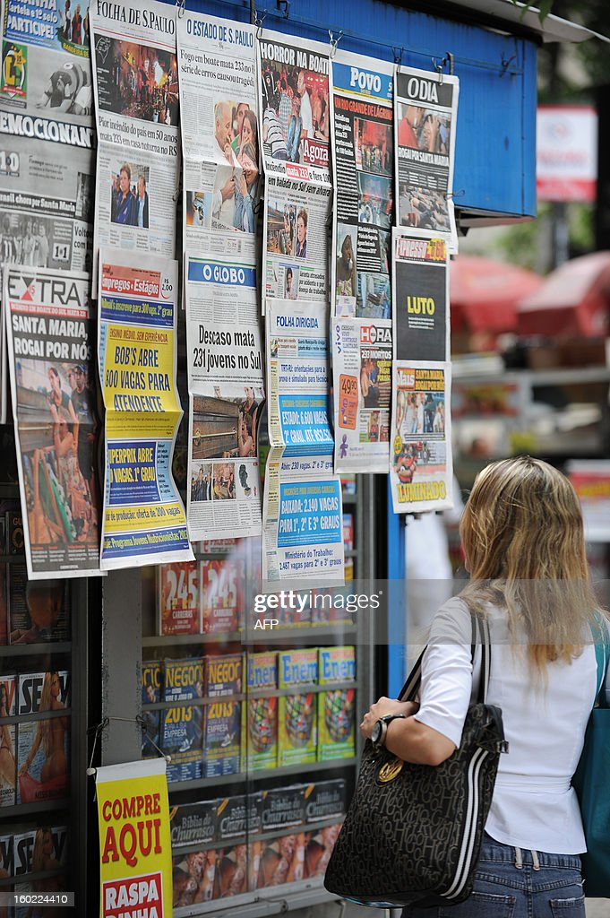 The front pages of the main Brazilian newspapers in a newsstand in Rio de Janeiro, Brazil, on January 28, 2013 have images and headlines related to the tragedy that occured on the eve in the southern city of Santa Maria, when a blaze in a disco killed 233 youngsters. A massive blaze at a nightclub in Brazil killed more than 230 people and left relatives desperately searching for loved ones as horrific accounts emerged of a tragic rush to escape the inferno.