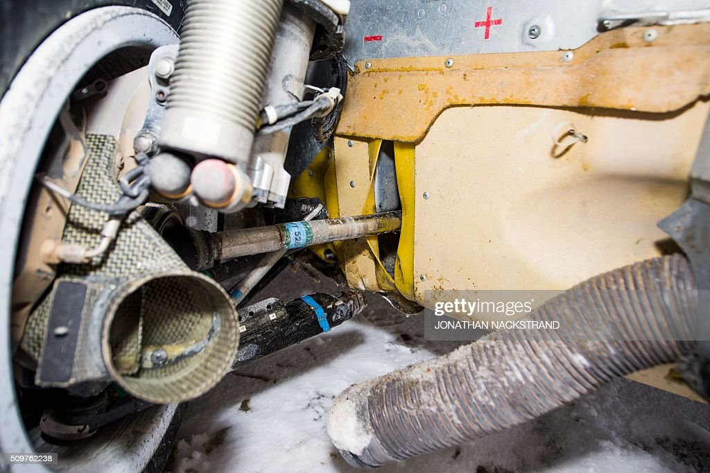 The front right car wheel of Citroen DS3 WRC drived by Kris Meeke of Britain and his co-driver Paul Nagle of Ireland is pictured as the car is parked during the 8nd stage of the Rally Sweden, second round of the FIA World Rally Championship on February 12, 2016 in Rojden, near Svullrya, Norway. / AFP / JONATHAN NACKSTRAND