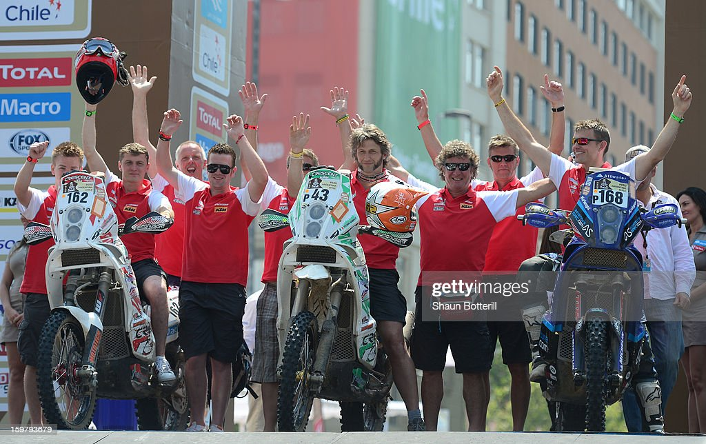 The Front Row GB team of Tim Forman (162), Stanley Watt (43) and Lyndon Poskitt (168) celebrate during the podium presentations at the end of the 2013 Dakar Rally on January 20, 2013 in Santiago, Chile.