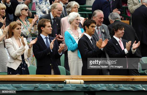 The front row of the Royal Box on Centre Court Princess Beatrice Dave Clark Harry Diamond and Rory McIlroy applaud during day eight of the 2011...