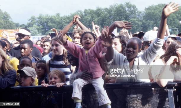 The front rows of the audience watching Run DMC perform at Respect Festival Finsbury Park London 21st July 2001
