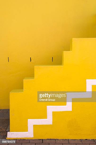 The front steps of a yellow Bo-Kaap house