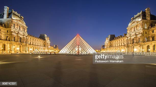 The front view of Louvre museum at dusk