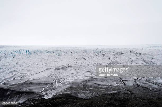 The frozen and barren wasteland of ice and crevasse on the surface of the Greenland Ice Sheet.