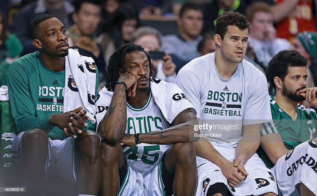 The frustration shows on the Celtics bench as Boston falls to their ninth straight defeat. Left to right are, Jeff Green, Gerald Wallace, Kris Humphries and Vitor Faverani. The Boston Celtics hosted the Houston Rockets in a regular season NBA game at TD Garden.