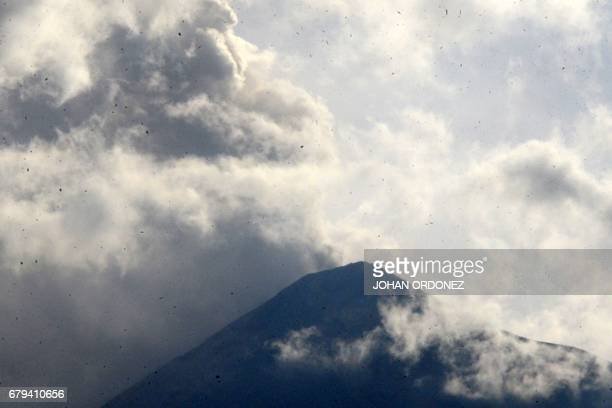 TOPSHOT The Fuego volcano is seen from Alotenango municipality Sacatepequez department about 30 km southwest of Guatemala City as it erupts on May 5...