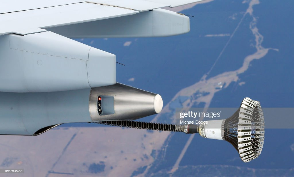 The fuel line from a KC-30A Multi Role Tanker Transport aircraft extends out during the Australian Defence Force Air-To-Air refuelling on February 27, 2013 in Melbourne, Australia. The Australian Federal Government is planning to replace the ageing F/A-18 and already retired F-111 bomber with a fleet of 100 F-35 Lightning ll, at a cost of AUD$16 billion, with the first of the jets to be delivered to the Royal Australian Air Force at the end of 2014.