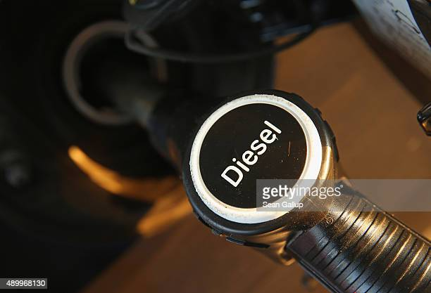 The fuel nozzle of a diesel pump deposits diesel fuel into a Volkswagen car at a petrol staiton on September 25 2015 in Berlin Germany Volkswagen is...