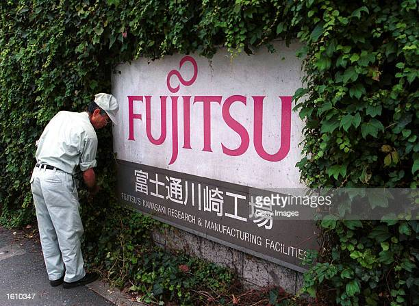 The Fujitsu logo is on display in front of the company''s headquarters for Fujitsu Kawasaki August 24 2001 in Tokyo Japan The company announced a...