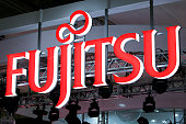 The Fujitsu Ltd logo is displayed at the company's booth at the CuttingEdge IT Electronics Comprehensive Exhibition in Chiba Japan on Tuesday Oct 7...