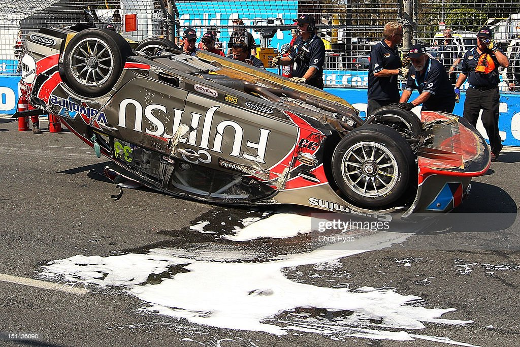 The #33 Fujitsu Racing GRM Holden car lays on the track after Ricky Taylor of the USA had a rollover during qualifying / race ## for the Gold Coast 600, which is round 12 of the V8 Supercars Championship Series at the Gold Coast Street Circuit on October 20, 2012 on the Gold Coast, Australia.