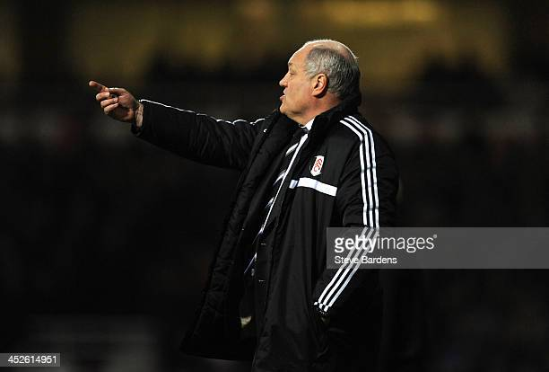 The Fulham Manager Martin Jol gives instructions during the Barclays Premier League match between West Ham United and Fulham at Boleyn Ground on...