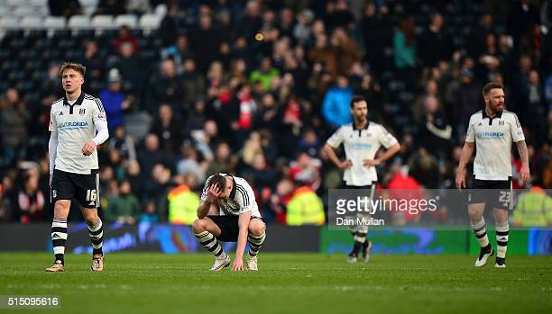 The Fulham players look dejected after conceding a second goal during the Sky Bet Championship match between Fulham and Bristol City at Craven...