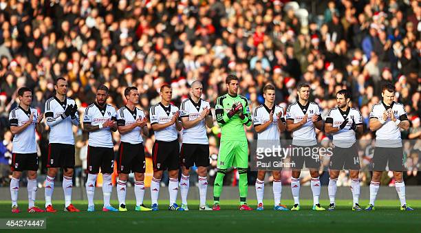 The Fulham players take part in a minutes applause in remembrance of Nelson Mandela prior to kickoff during the Barclays Premier League match between...