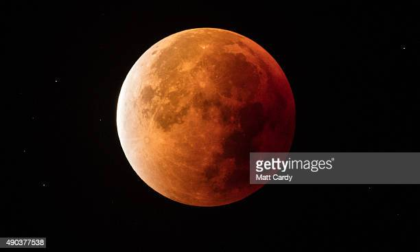 The full eclipse of the moon ends as the moon leaves the shadow of the Earth on September 28 2015 in Glastonbury England Tonight's supermoon so...