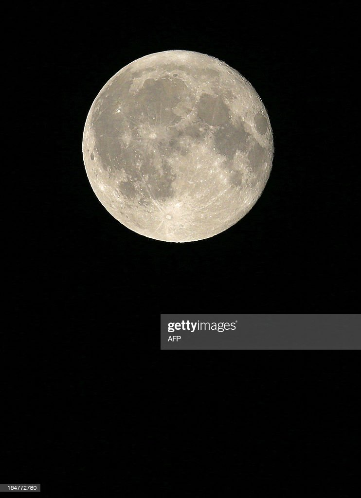 The full moon is seen in Vienna on March 28, 2013.