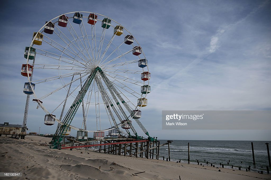 The Fun Town pier ferris wheel that was damaged by Superstorm Sandy remains damaged and at waters edge, February 19, 2013 in Seaside Heights, New Jersey. Governor Chris Christie has estimated that damage in New Jersey caused by Superstorm Sandy could reach $37 billion.