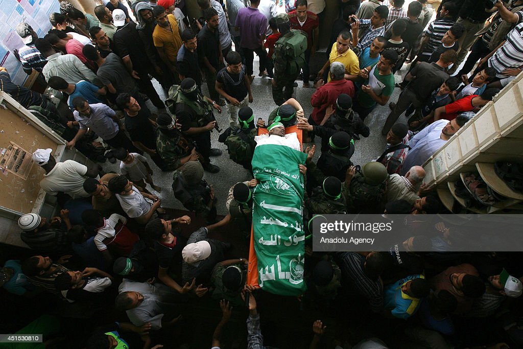 The funeral ceremony is held for Palestinian Mohammed Obeid,who died in an Israeli airstrike in the Gaza Strip late Sunday, on June 30,2014. Israeli aircraft fired a missile into a group of Palestinians in al-Qarara village near the southern city of Khan Younis, left one person dead and three others injured.