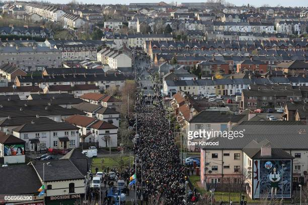 The funeral coetege leads thousands of mourners through Bogside towards the cemetary during Martin McGuinness' Funeral at the Derry City Cemetery on...
