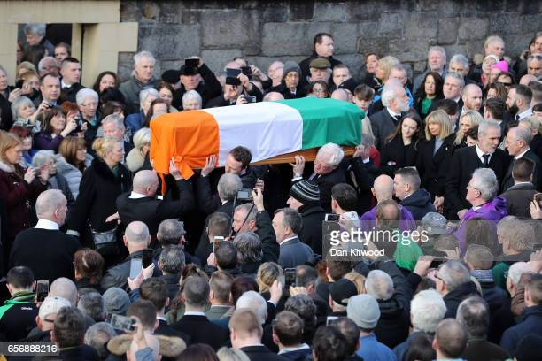 The funeral cortege leaves St Columba's Church and makes it way to Derry City Cemetery on March 23 2017 in Londonderry Northern Ireland The funeral...