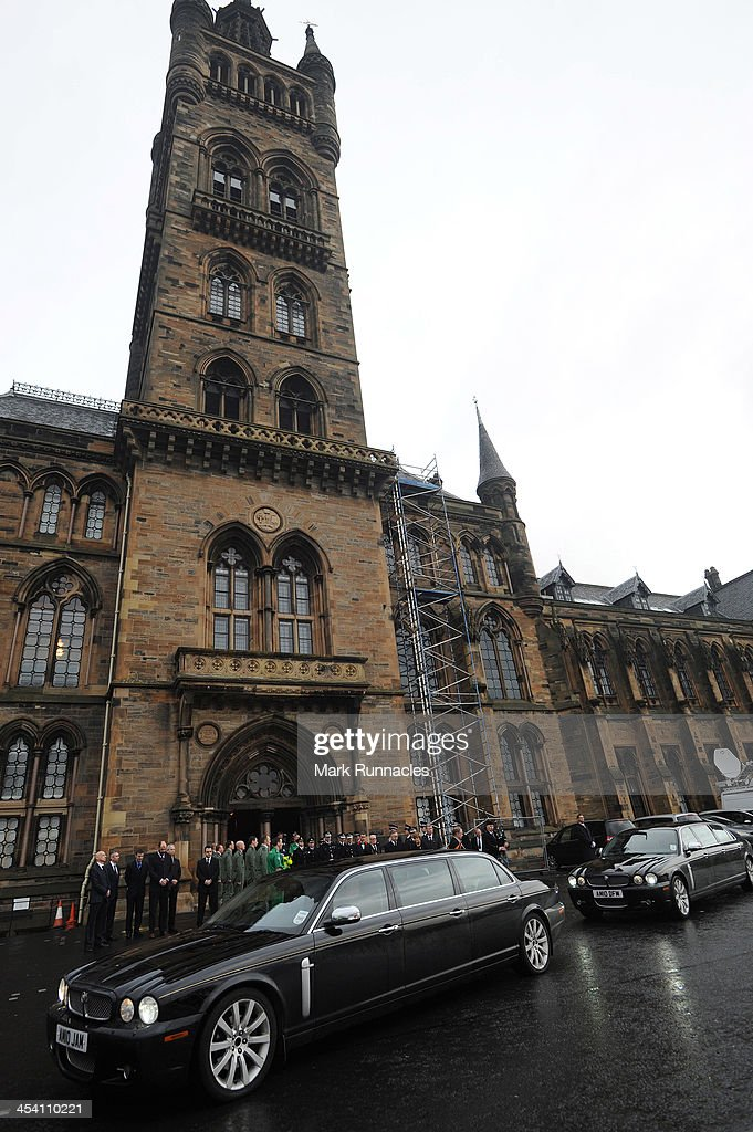 The funeral cortege leaves the University of Glasgow's Bute Hall after the service for Helicopter Pilot David Traill who died when the Helicopter he...
