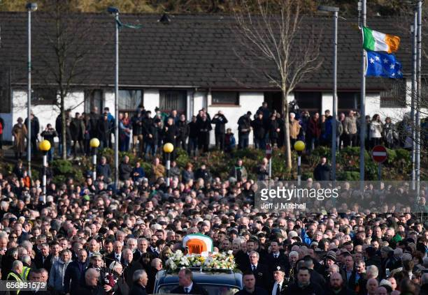 The funeral cortege makes it way to Derry City Cemetery on March 23 2017 in Londonderry Northern Ireland The funeral is held for Northern Ireland's...