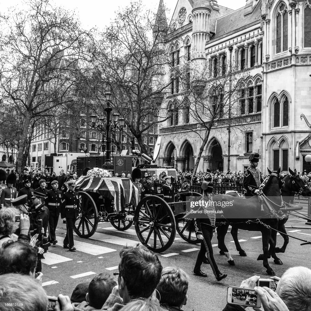 The funeral cortege of former British Prime Minister Baroness Thatcher passes by the Royal Courts of Justice on April 17, 2013 in London, England. Dignitaries from around the world today join Queen Elizabeth II and the Prince Philip, Duke of Edinburgh as the United Kingdom pays tribute to former Prime Minster Baroness Thatcher with a Ceremonial funeral with military honours at St Paul's Cathedral. Lady Thatcher, who died last week, was the first British female Prime Minister and served from 1979 to 1990.