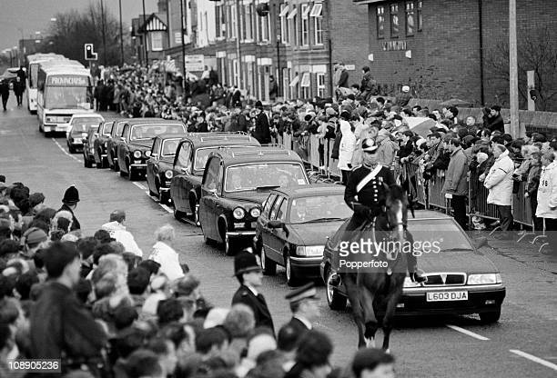 The funeral cortege of Sir Matt Busby former Manchester United manager passes Old Trafford Manchester on 27th January 1994