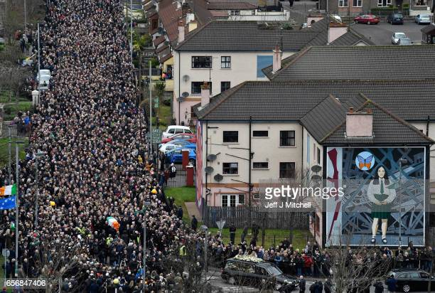 The funeral cortege passes a Republican mural as it makes it way through the streets of Derry on March 23 2017 in Londonderry Northern Ireland The...