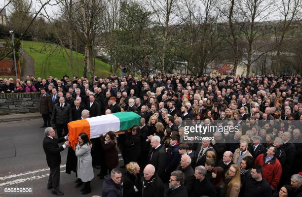 The funeral cortege passes through the streets of Derry on March 23 2017 in Londonderry Northern Ireland The funeral is held for Northern Ireland's...