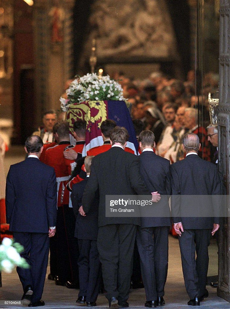 The Funeral Of Diana, Princess Of Wales. Earl Spencer With His Arms Around Prince Harry And Prince William Comforting Them As They Follow Their Mother's Coffin Inside Westminster Abbey With Prince Charles And Prince Philip.