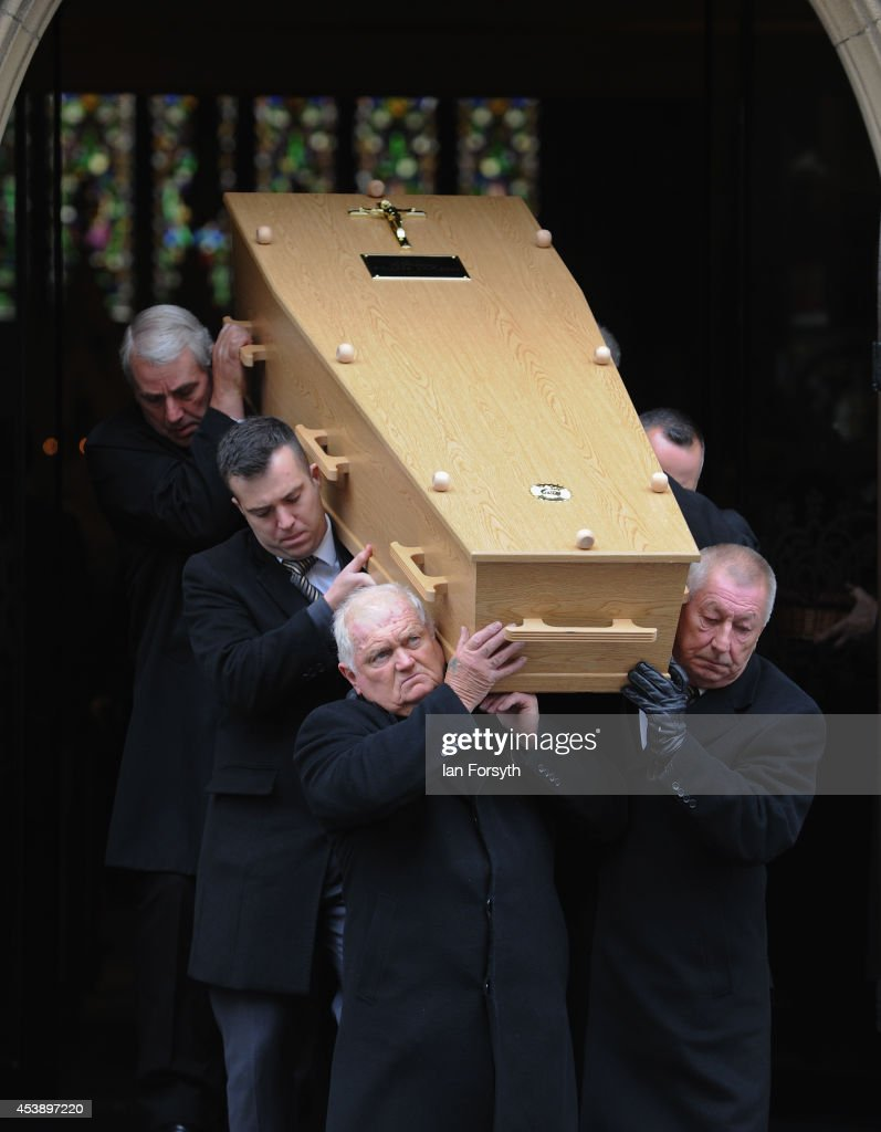 The funeral of lifelong Newcastle United fan Liam Sweeney takes place at St Mary's Cathedral on August 21, 2014 in Newcastle Upon Tyne, England. Mr Sweeney, 28, and fellow Newcastle United fan Mr John Alder, 63, died along with 296 others when the Malaysian flight MH17 they were travelling on was shot down over Ukraine on 17 July.