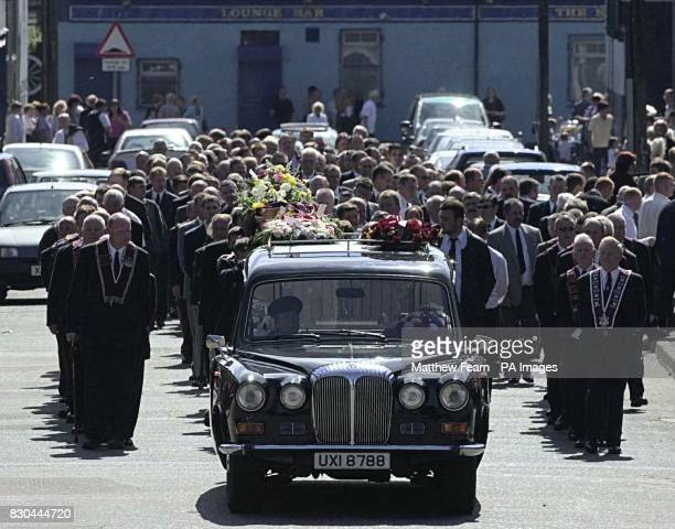 The funeral party of Bobby Mahood makes its way towards the Crumlin Road in Belfast Several hundred people gathered for the funeral of one of the...