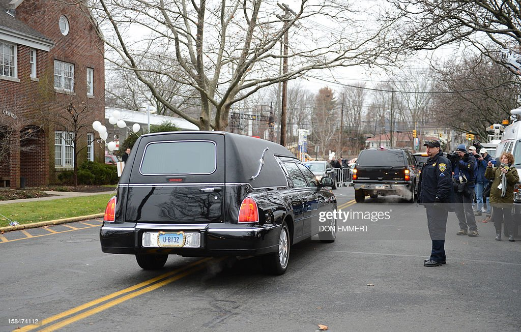 The funeral procession begins the journey to the cemetery following services for six year-old Noah Pozner, who was killed in the December 14, 2012 shooting massacre in Newtown, Connecticut, at Abraham L. Green and Son Funeral Home on December 17, 2012 in Fairfield, Connecticut. Today is the first day of funerals for some of the twenty children and seven adults who were killed by 20-year-old Adam Lanza on December 14, 2012. AFP PHOTO / Don EMMERT