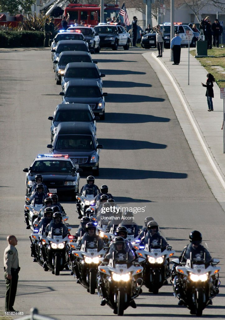 The funeral procession for slain Riverside police Officer Michael Crain arrives at Grove Community Church in Riverside, California, February 13, 2013. Officer Crain was allegedly killed by ex LAPD officer Chris Dorner on February 7, 2013.