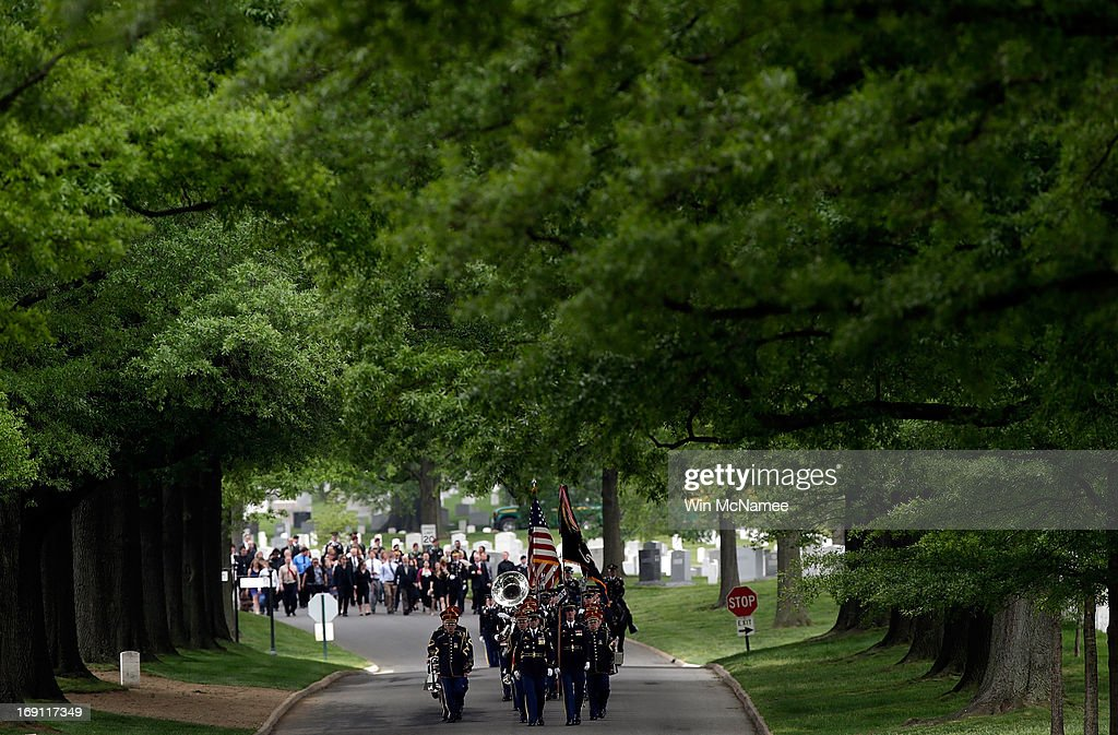 The funeral procession for Staff Sergeant Francis G. Phillips makes its way down Bradley Drive during a burial service at Arlington National Cemetery May 20, 2013 in Arlington Virginia. Phillips, from Meridian, New York was killed in combat in the Maiwand district of Afghanistan when the vehicle he was riding in was struck by an improvised explosive device.