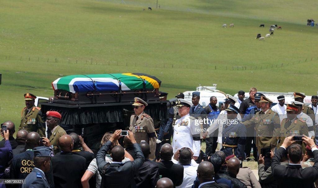 The funeral procession leaving for the grave site following Madiba's State Funeral on December 15, 2013 in Qunu, South Africa. Nelson Mandela passed away on the evening of December 5, 2013 at his home. He is laid to rest at his homestead in Qunu during a State Funeral.