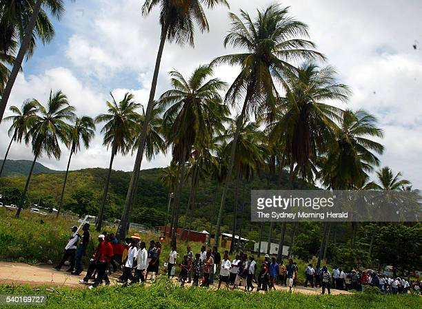 The funeral procession of Cameron Doomadgee who died in police custody on Palm Island Queensland 11 December 2004 SMH Picture by ANDY ZAKELI