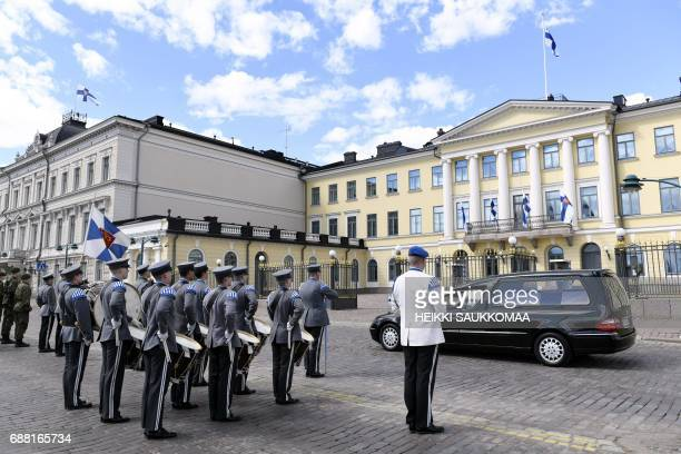 The funeral procession of Finland's former President Mauno Koivisto stops in front of the Presidential Castle in Helsinki during the state funeral...