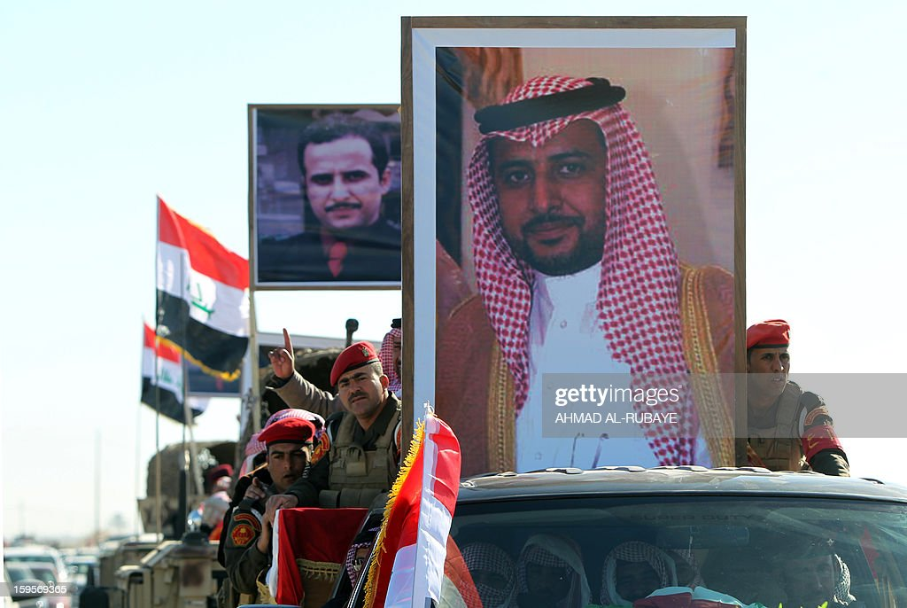 The funeral procession of MP Ayfan Saadun al-Essawi, of the secular Sunni-backed Iraqiya bloc, takes place in the western town of Fallujah, 50 kilometers from Baghdad, on January 16, 2013, in Anbar province. Essawi, 37-years-old, was killed by a suicide bomber who wrapped his arms around the lawmaker before blowing himself up, as a political crisis engulfed Iraq.