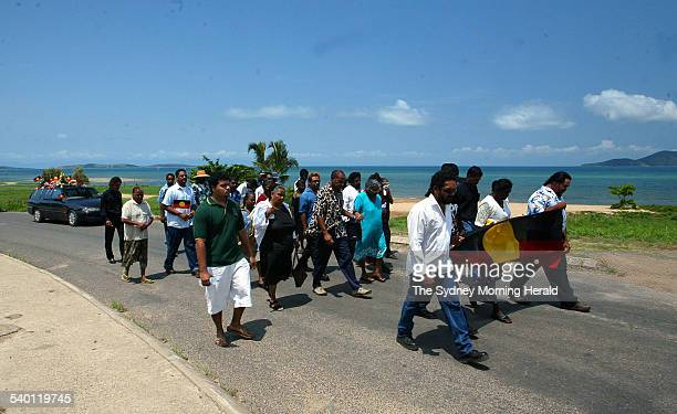 The funeral procession passes the ocean on the way to the burial site during the funeral of Cameron Doomadgee who died in police custody on Palm...