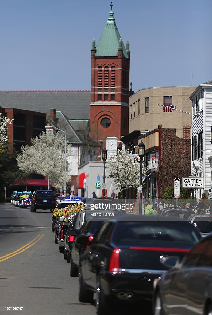 The funeral procession passes through town for 29-year-old Krystle Campbell, who was one of three people killed in the Boston Marathon bombings, on April 22, 2013 in Medford, Massachusetts. The 29-year-old restaurant manager was raised in Medford. Massachusetts Gov. Deval Patrick has asked residents to observe a moment of silence at the time of the first explosion at 2:50 p.m. this afternoon.