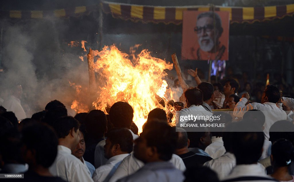 The funeral pyre of Indian Hindu nationalist Shiv Sena party leader Bal Thackeray goes up in flames in Mumbai on November 18, 2012. Huge crowds gathered in Mumbai to witness the funeral procession of Bal Thackeray, chief of the Hindu nationalist Shiv Sena party and one of India's most divisive politicians. Thackeray, who called his followers 'Hindu warriors' and was widely accused of stoking ethnic and religious violence, died aged 86, triggering a virtual shutdown of the city. AFP PHOTO/INDRANIL MUKHERJEE