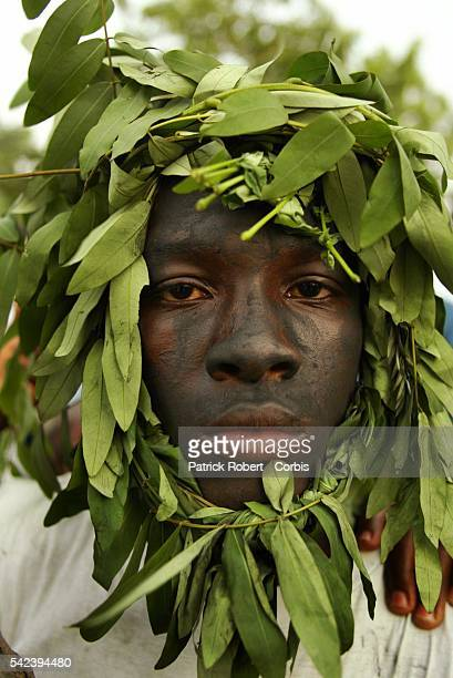 The funeral takes place of the assasinated Ivorian artist killed by death squads Kamara 'H' as an Ivorian is camoflaged with leaves and branches as a...