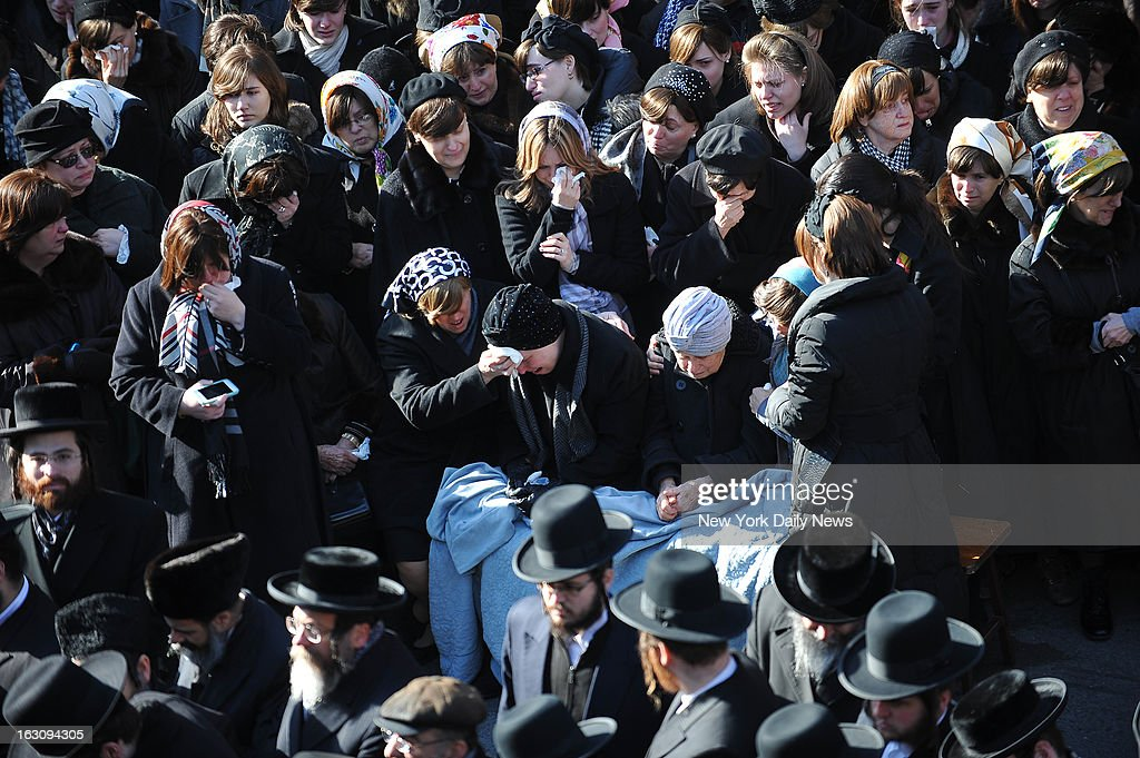 The funeral was held for a young Hassidic couple Raizel Glauber and Nachman Glauber killed this morning heading for the hospital to deliver their first child, were killed by a hit and run driver while in a livery cab at Kent Ave. and Wilson St. in Williamsburg, Brooklyn early this morning. The pregnant woman lived long enough for the baby to be born alive at Bellevue. March 3, 2013