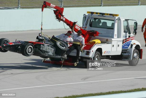 The G Force/Chevrolet of John Herb is towed off the track after crashing during practice for the 20th Anniversary Grand Prix of Miami IRL IndyCar...